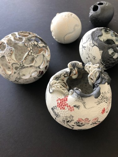 """Darina Karpov - """"Orbs of perfect song into our deep, dear silence,"""" 2019, Porcelain with underglaze and glaze, dimensions ranging from 2.5–5 inch diameter"""