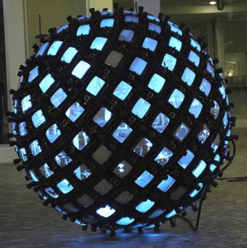 "Jonathan Schipper - ""Invisible Sphere (215 Points of View),"" 2005-2009, Steel Frame, 215 Monitors and Surveillance Cameras, Rubber, Cables, Approximately 6 ft in Diameter"