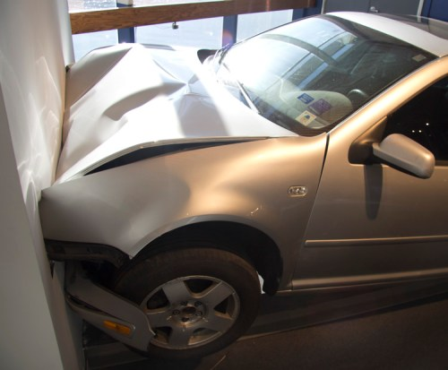 """Jonathan Schipper - """"Slow Motion Car Crash,"""" 2016, steel, hydraulics, car, dimensions- variable. Special Project installation at the Armory Show, Pier 92"""
