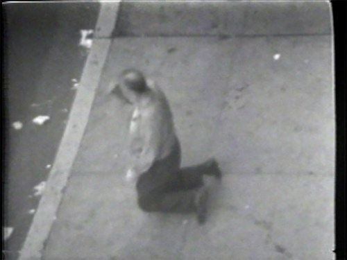 "Man Genuflecting - Still from video ""Atlantic in Brooklyn,"" 1971-72. Collection of the artist."