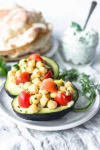 Chickpea salad avocado boats with pita bread and tzatziki