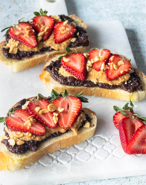 peanut butter chocolate spread on toast with strawberries
