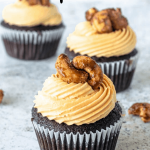 Caramel Cashew Cupcakes topped with caramelized cashews