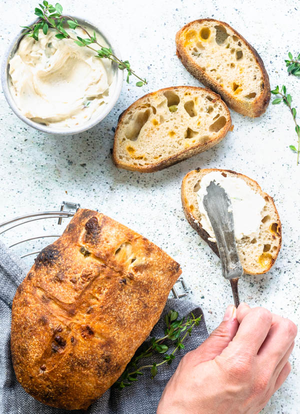 Cheddar Jalapeno Sourdough Bread with roasted garlic spread sliced flatly