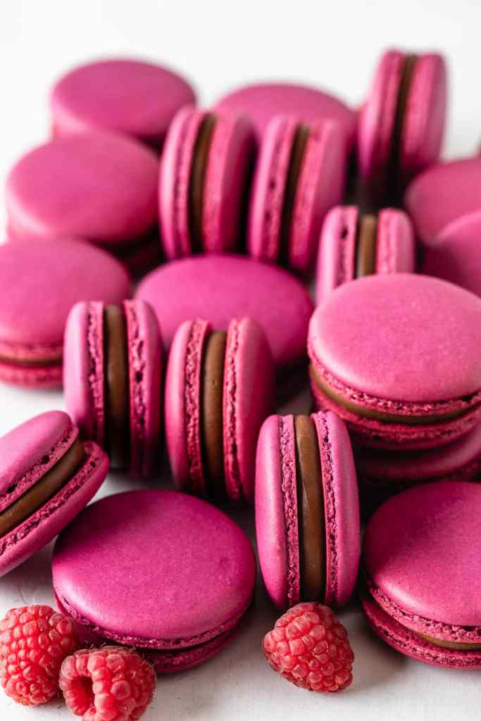 raspberry macarons with pink macaron shells, filled with chocolate ganache and raspberry jam.