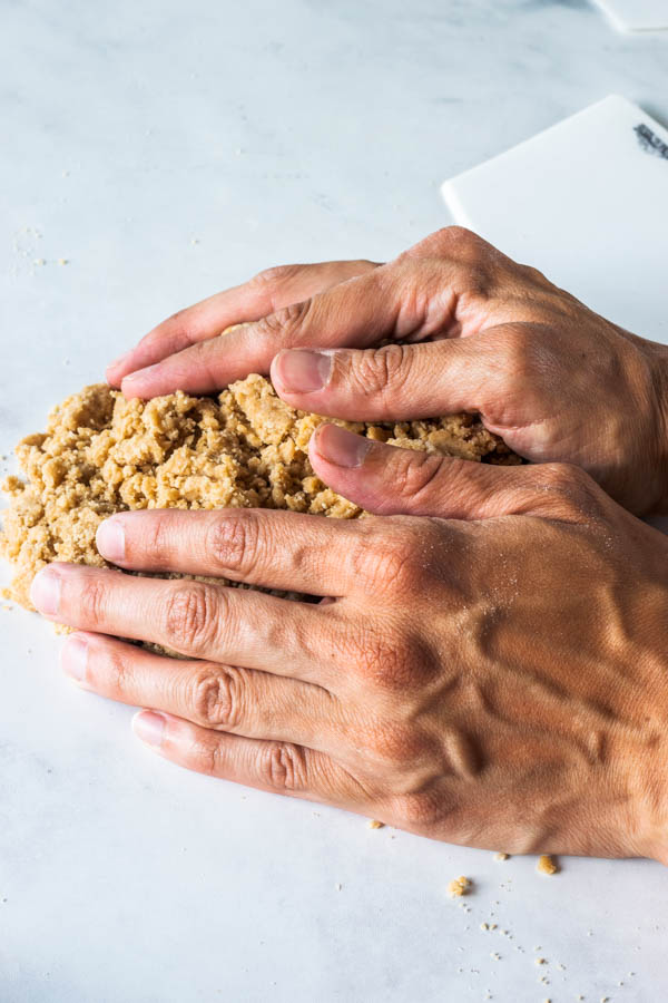 using hands to bring dough together