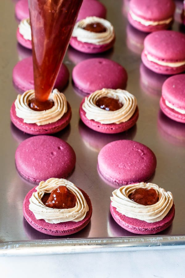 filling macarons with strawberry jam