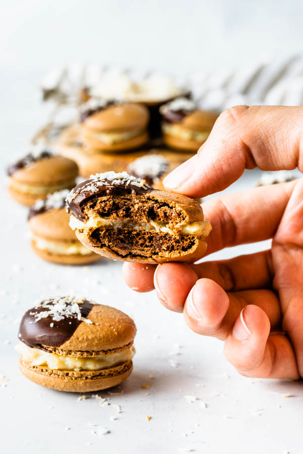 german chocolate macarons with coconut fudge filling bite shot