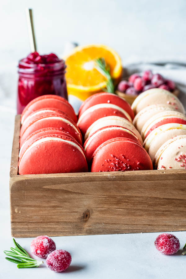 cranberry macarons with orange buttercream and cranberry in a box