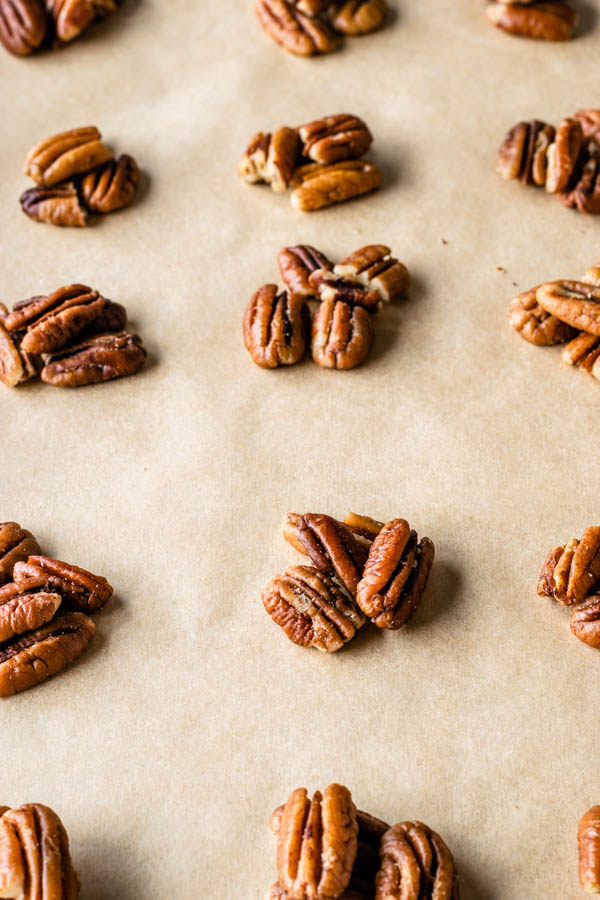 pecans on top of a baking sheet