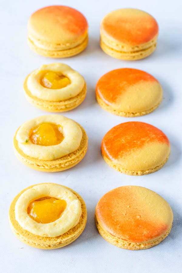 Mango Macarons ring of mango buttercream and mango jam in the middle