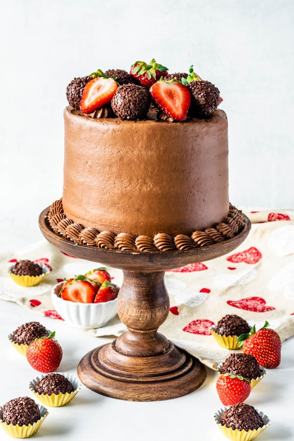 Strawberry Nutella Cake with strawberries and truffles on top
