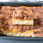 Sopapilla Cheesecake Bars with honey drizzle