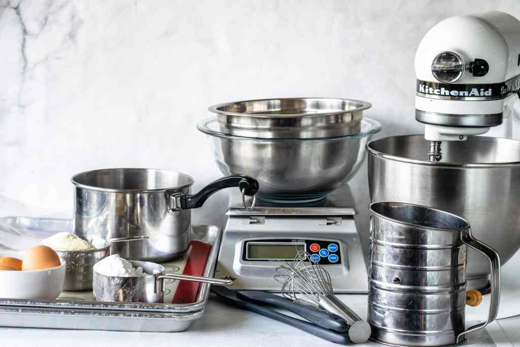 macaron equipments: eggs, scale, baking sheets, spatula, sifter, scale, mixer