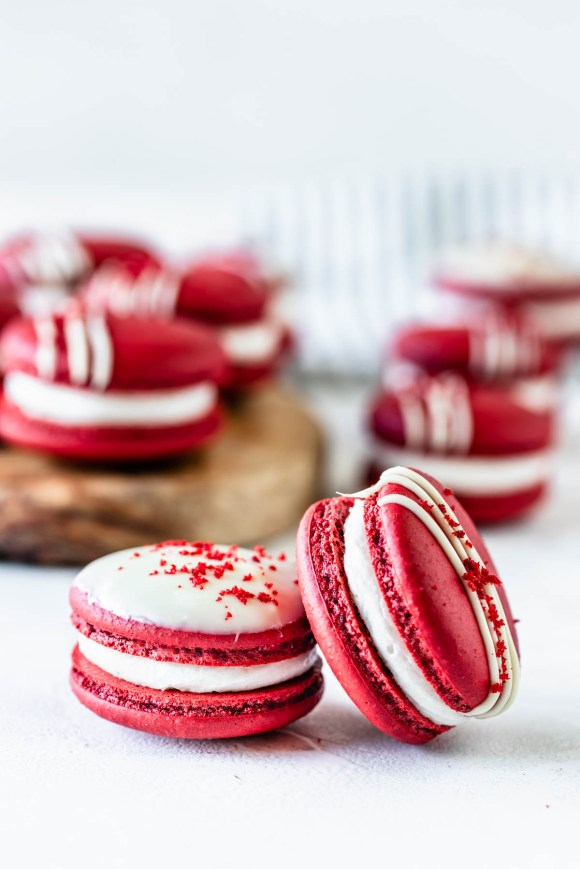 Red Velvet Macaron recipe drizzled with white chocolate topped with red velvet cake crumbs