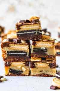 bars layered with blondie and brownie batter and oreos and golden oreos