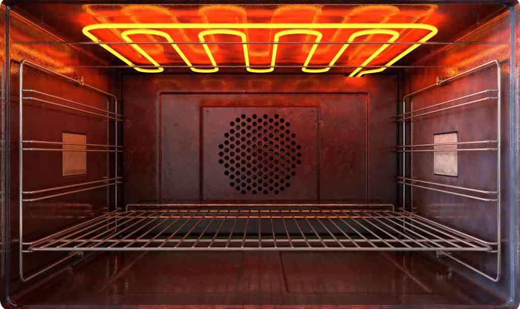 picture showing the inside of an oven with a top heating element on.