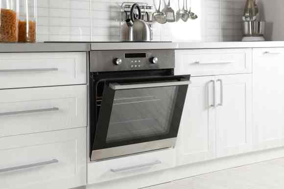 picture of an oven with a door half open