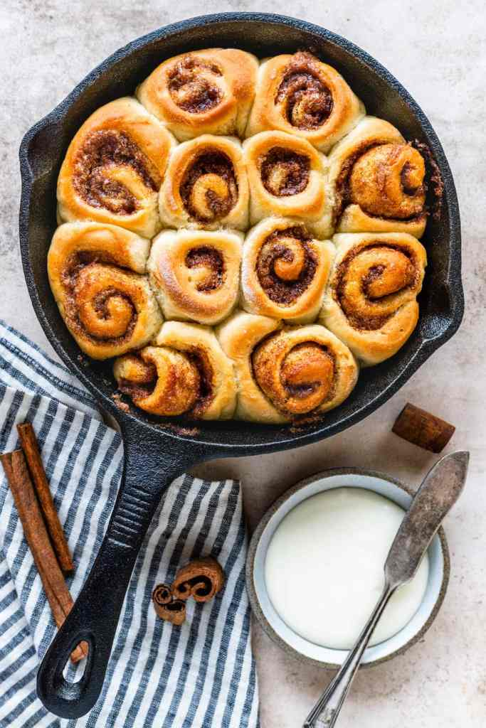 cinnamon rolls in a skillet without glaze on top.