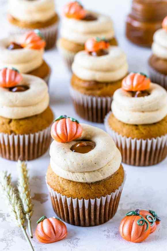 pumpkin cupcakes filled with dulce de leche, frosted with dulce de leche pumpkin russian buttercream.