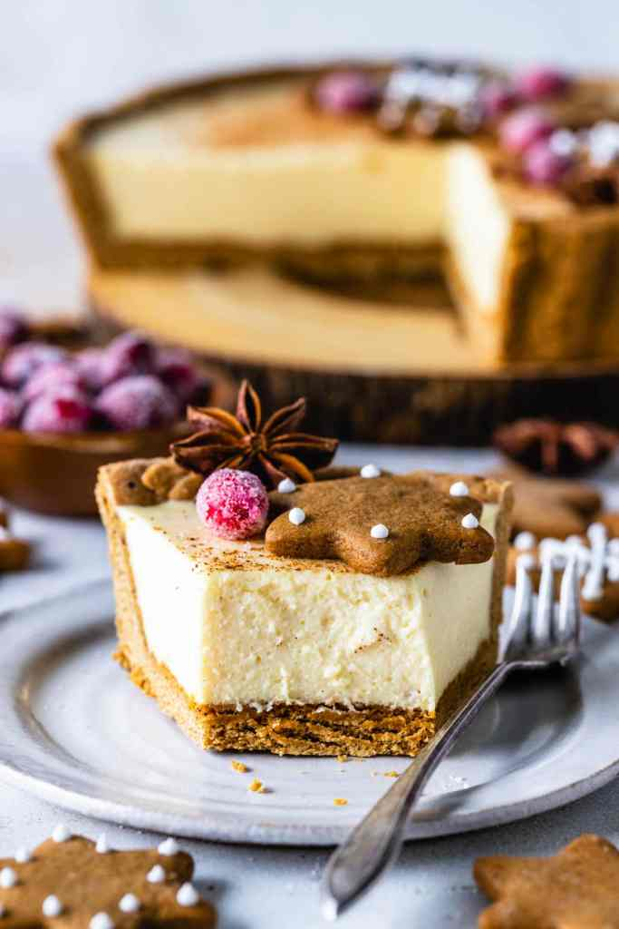 slice of Eggnog Pie topped with gingerbread cookies, rosemary sprigs and sugared cranberries.