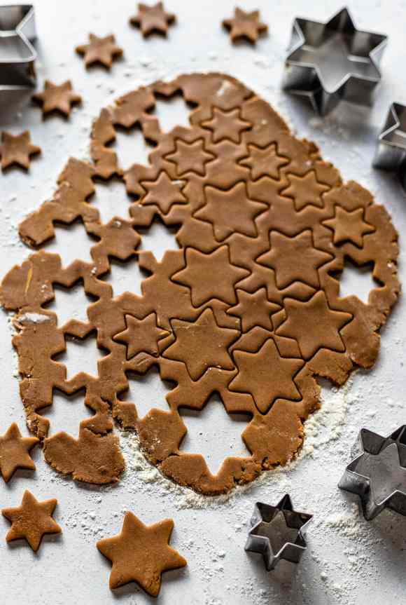 gingerbread cookie dough rolled out and cut into stars.