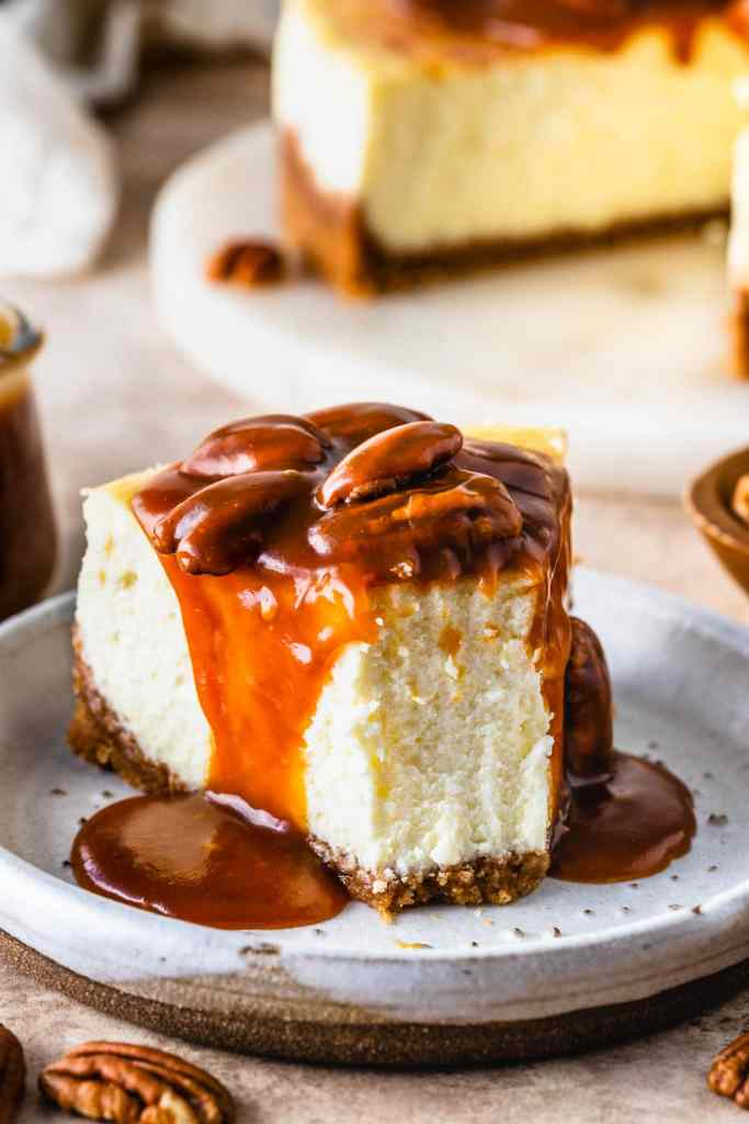 pecan cheesecake slice, topped with caramel.