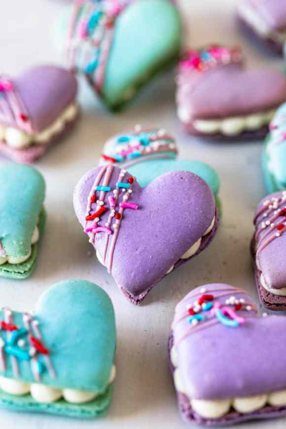 Heart Macarons filled with brownie, decorated with sprinkles and melted chocolate.