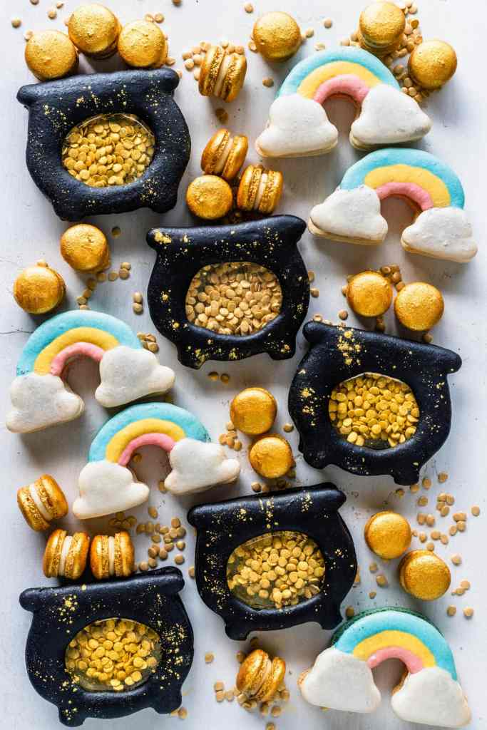 rainbow macarons and pot of gold macarons with golden mini macarons around.