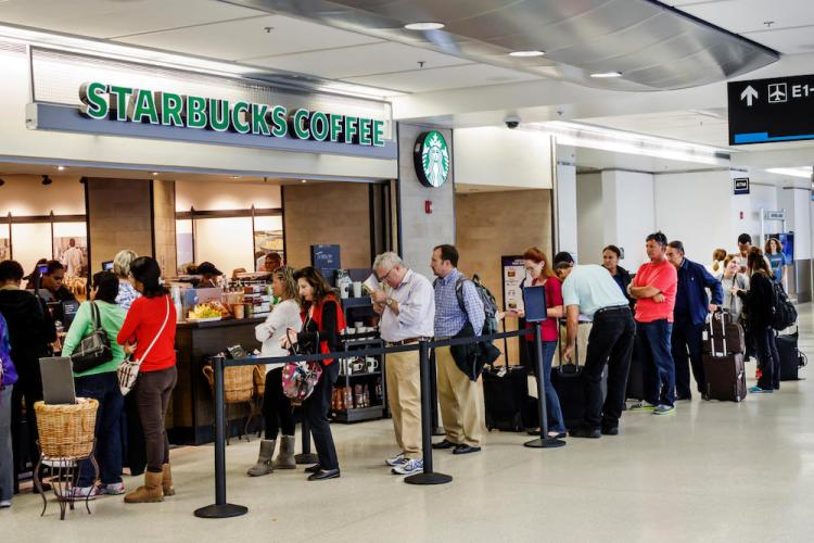 Miami Florida International Airport MIA inside terminal concourse gate area Starbucks Coffee line queue customers