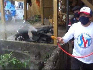 Nasdem Peduli, SYT Semprotkan 1.200 Liter Disinfektan Rumah Warga