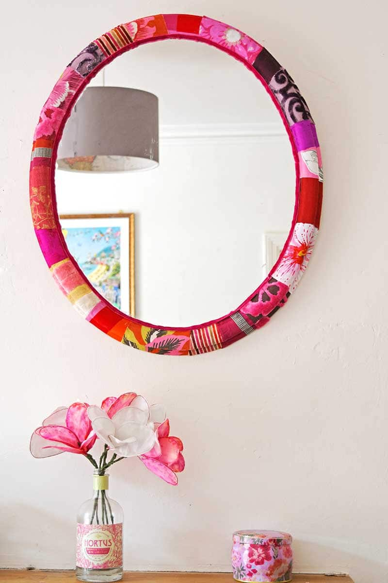Tutorial: Use your fabric scraps to brighten up a mirror frame.