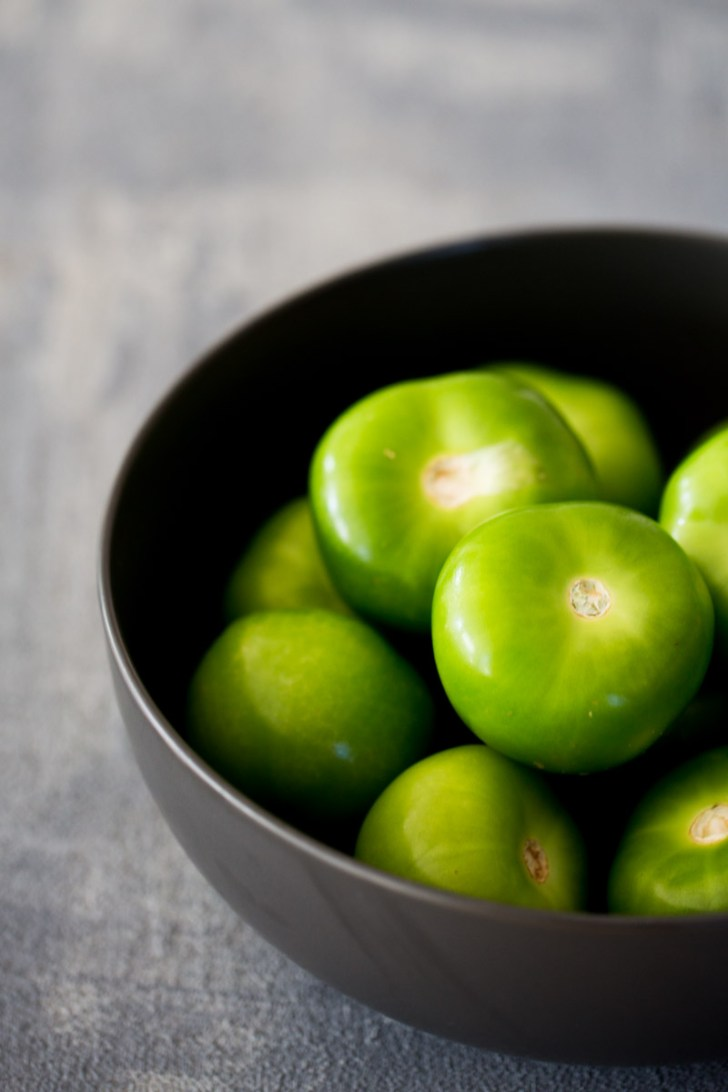 Tomatillos in a bowl to make mexican salsa verde