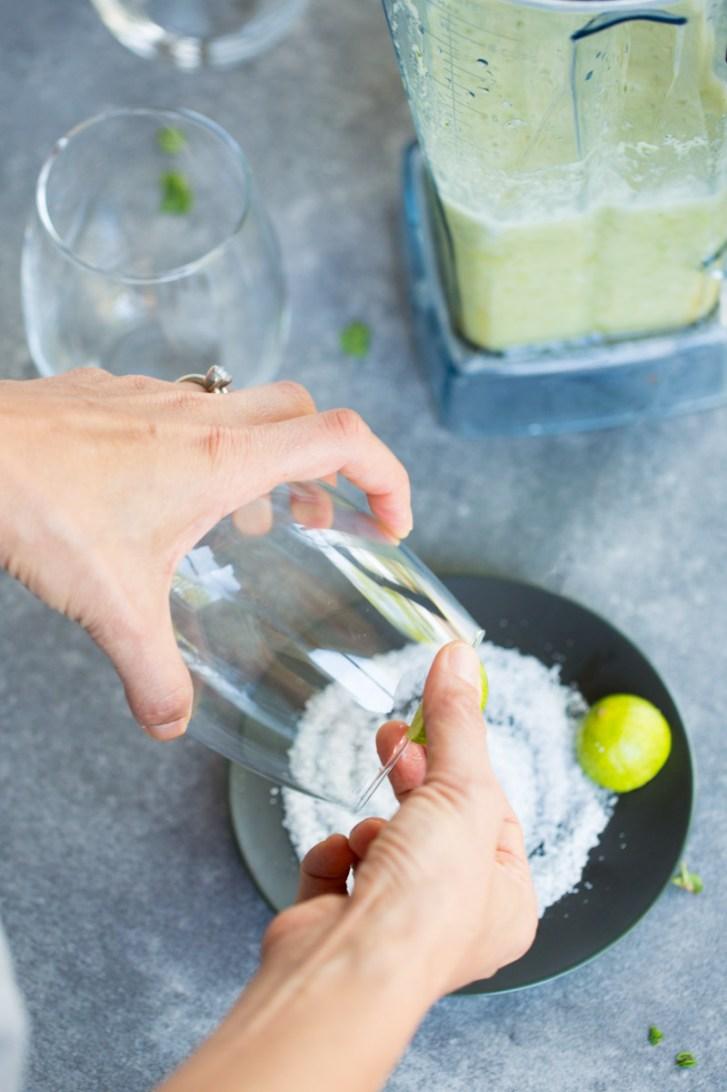 preparing a glass for margaritas