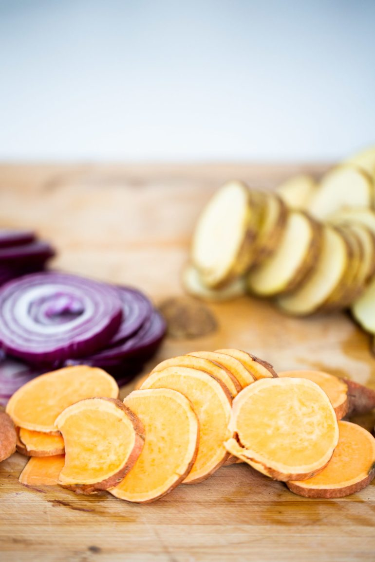 slices of potatoes, sweet potatoes and red onion