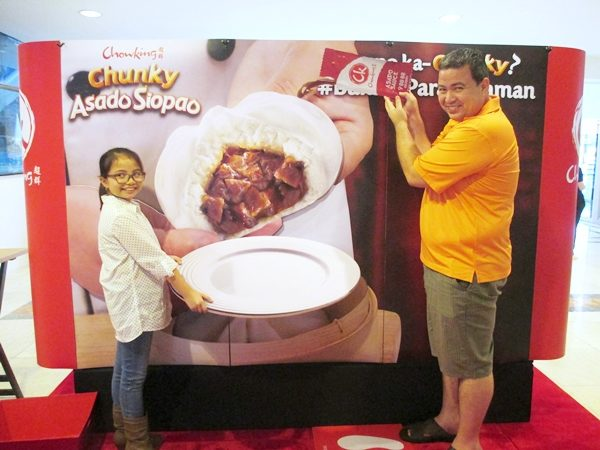 Customers playfully posed at the trick art station to capture their delicious encounter with the Chowking Chunky Asado Siopao.