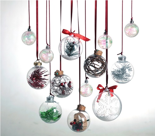 Fill these clear glass ornaments with tinsels, tiny berries and twigs, and moss.