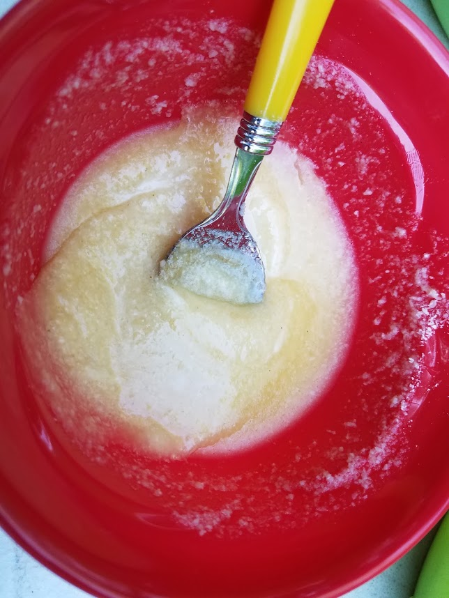 Garlic Butter Mixture in a red plastic bowl