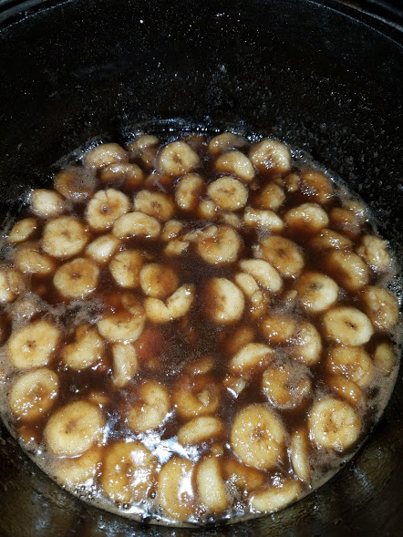 bananas foster with thick rum sauce boiling in my dutch oven