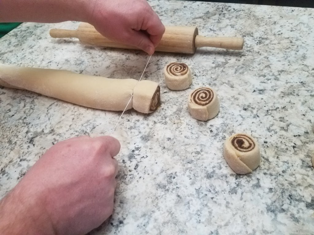 cutting cinnamon rolls