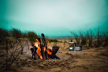 Campfire and coffee on beach