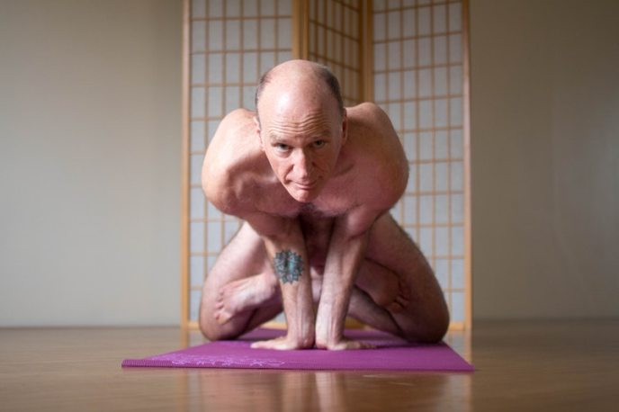 Nude yoga instructor.