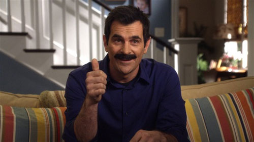 Image of Phil Dunphy wearing a mustache giving a thumbs up.