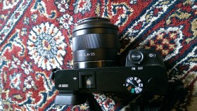The Sony / Zeiss 35mm F/2.8 on an a6000 body... it's pretty compact.