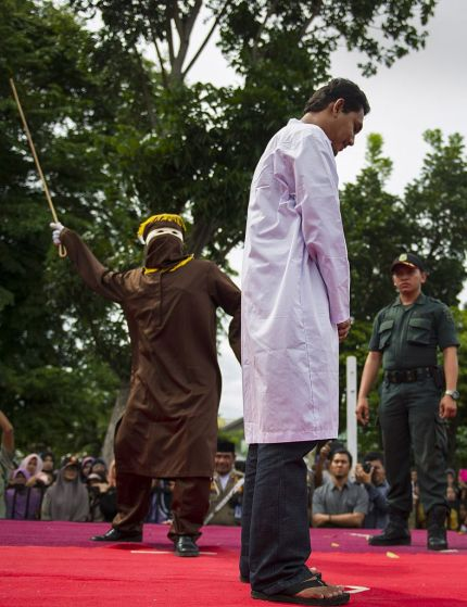 Men facing the cane in Indonesia