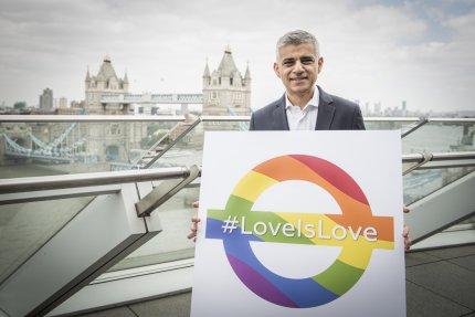 Sadiq Khan holding a rainbow roundel