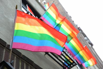 TO GO WITH AFP STORY BY LUIS TORRES Gay pride flags fly from the Stonewall Inn on Christopher Street June 23, 2009 in the Greenwich Village section of New York as the community marks the 40th anniversary of the Stonewall riots. The disturbances began on the night of June 28, 1969 as a protest by gays against police harassment and helped trigger the modern US gay rights movement. AFP PHOTO/Stan Honda (Photo credit should read STAN HONDA/AFP/Getty Images)