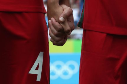 RIO DE JANEIRO, BRAZIL - AUGUST 07: Players of Portugal holding their hands at their national anthem for the Men's Group D first round match between Honduras and Portugal during the Rio 2016 Olympic Games at the Olympic Stadium on August 7, 2016 in Rio de Janeiro, Brazil. (Photo by Alexander Hassenstein/Getty Images)