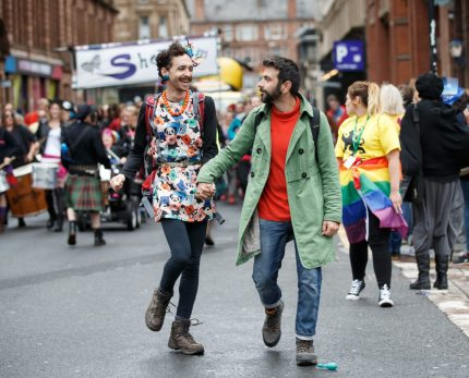 GLASGOW, SCOTLAND - AUGUST 19: Participants hold hands during the Glasgow Pride march on August 19, 2017 in Glasgow, Scotland. The largest festival of LGBTI celebration in Scotland has been held every year in Glasgow since 1996.  (Photo by Robert Perry/Getty Images)
