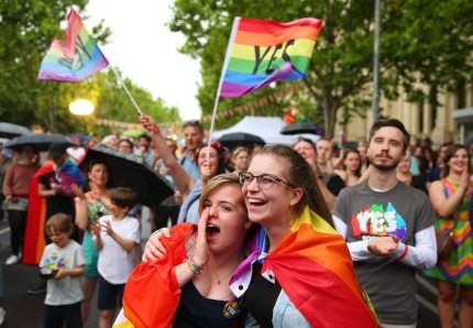 MELBOURNE, AUSTRALIA - NOVEMBER 15:  Supporters of the 'Yes' vote for marriage equality celebrate at Melbourne's Result Street Party on November 15, 2017 in Melbourne, Australia. Australians have voted for marriage laws to be changed to allow same-sex marriage, with the Yes vote claiming 61.6% to to 38.4% for No vote. Despite the Yes victory, the outcome of Australian Marriage Law Postal Survey is not binding, and the process to change current laws will move to the Australian Parliament in Canberra.  (Photo by Scott Barbour/Getty Images)